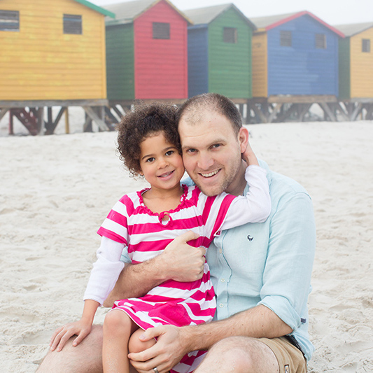 Father And Daughter On Muizenberg Beach Cape Town