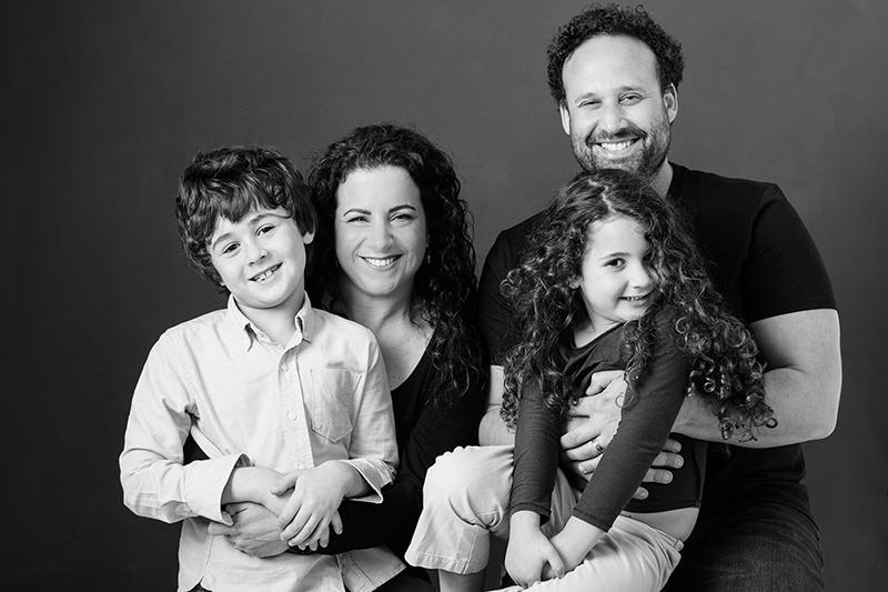 Black And White Portrait Of Family In Studio