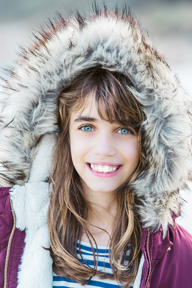 Portrait Of Young Girl On Beach In Winter