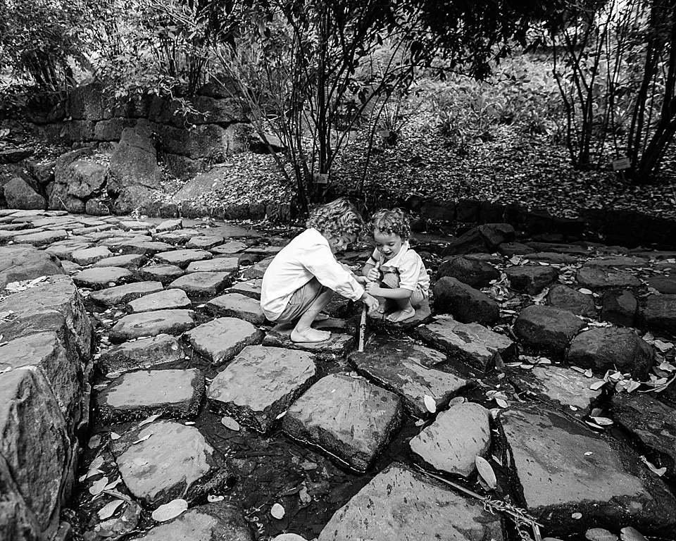black and white photo of two brothers playing